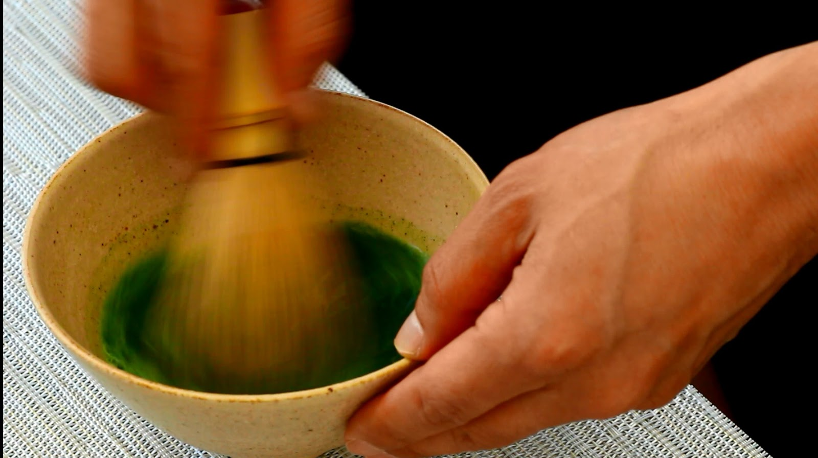 whisking matcha green tea