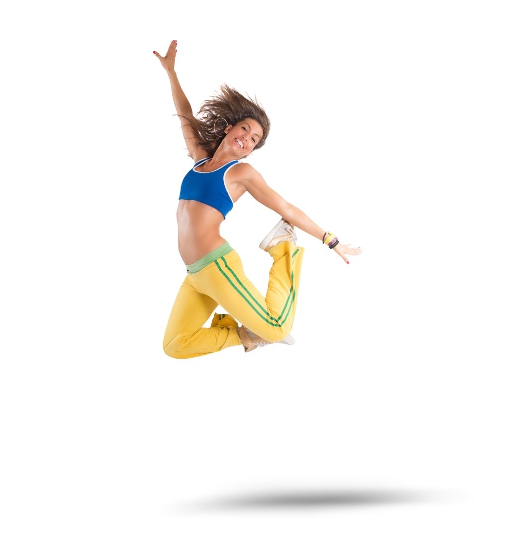 A dancer jumps in a zumba choreography