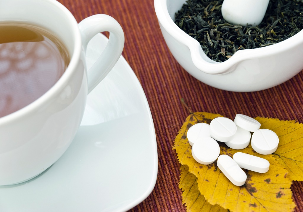 picture of tea and pills. Health concept.