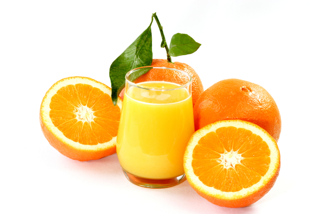 Orange juice with fruits isolated on white Background